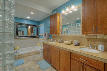 Rinse away desert sand in the primary bath's separate glass shower or dual vanity sinks.