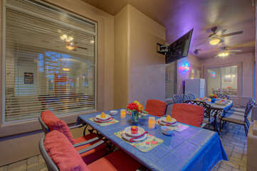 Back porch has new comfortable furnishings plus a TV, Sonos stereo and beverage fridge.