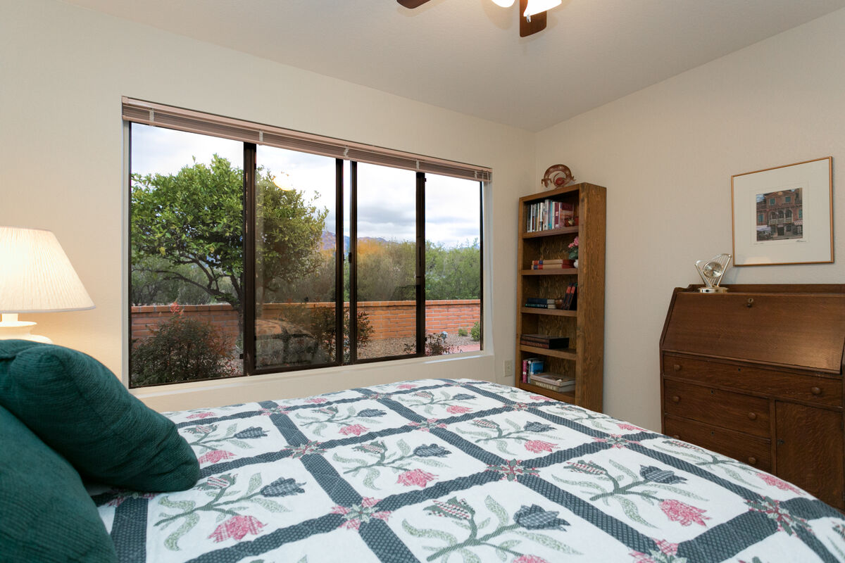 second guest bedroom with view of patio