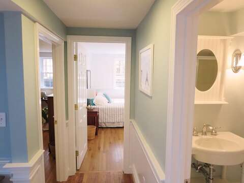 Hallway on the lower level, the full bath is to the right.- 44 Cranberry Way Chatham Cape Cod - New England Vacation Rentals