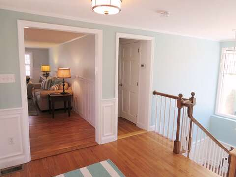 View of living room. Hallway to bedrooms/bath and stairs to lower level - 44 Cranberry Way Chatham Cape Cod - New England Vacation Rentals