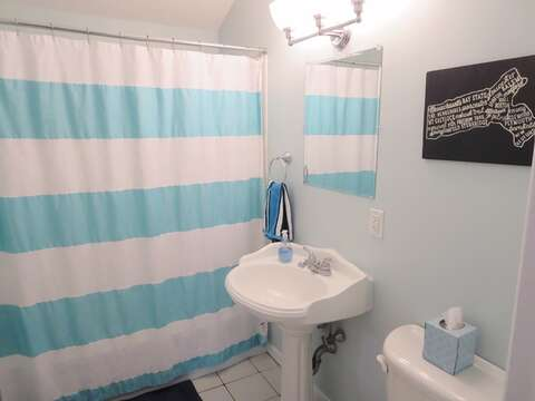 Bathroom # 1 on the 1st floor off of the hallway with a tub and shower - 44 Cranberry Way Chatham Cape Cod - New England Vacation Rentals
