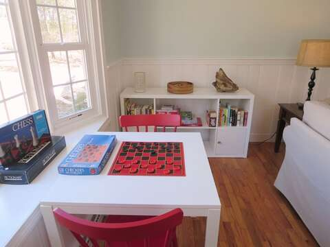 Game table with lots of board games - 44 Cranberry Way Chatham Cape Cod - New England Vacation Rentals