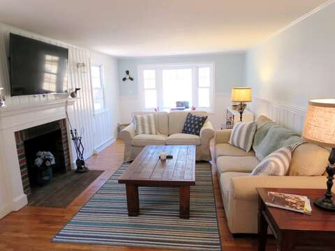 Living room with large flat screen TV. WiFi and Central AC throughout - 44 Cranberry Way Chatham Cape Cod - New England Vacation Rentals