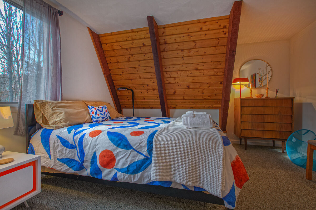 Upstairs bedroom with nearby dresser