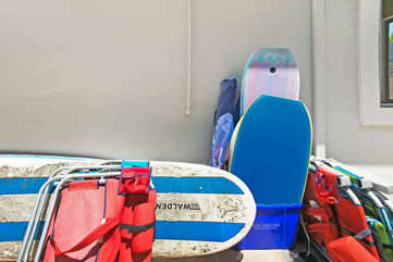Plenty of beach gear for everyone, adult and kids surf boards, boogie boards, sand toys, and beach chairs.