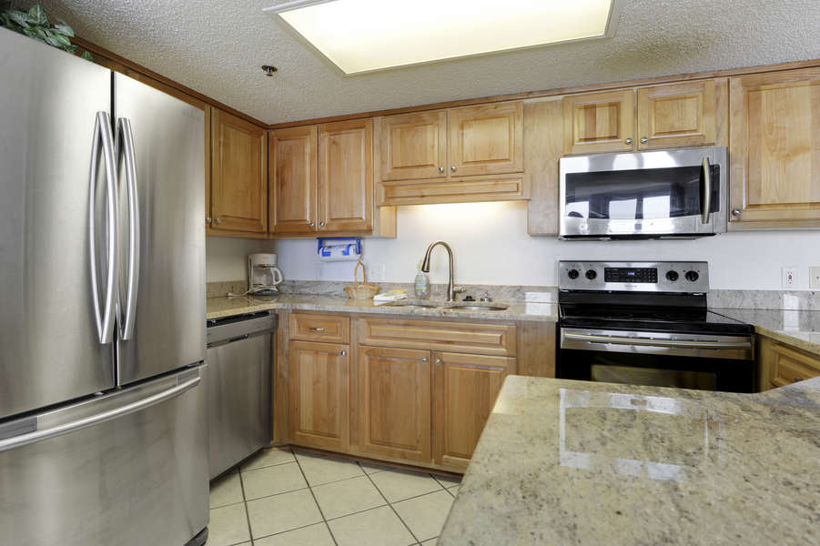 Updated Kitchen has Stainless Steel Appliances, New Cabinets and Granite Counter Tops.