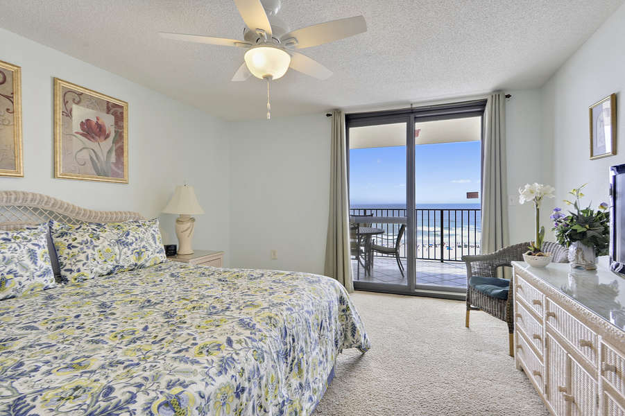 Master Bedroom with a King Size Bed and Private Balcony Access