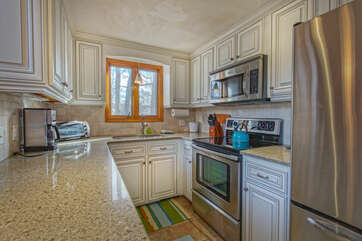 Kitchen with refrigerator and nearby oven