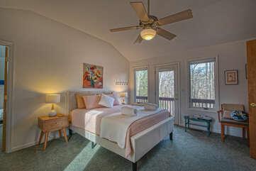 Bedroom with ceiling fan and door to deck