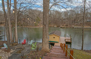 View of lake, dock and boathouse