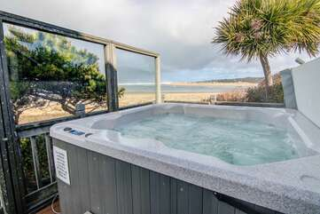 Sheltered hot tub.