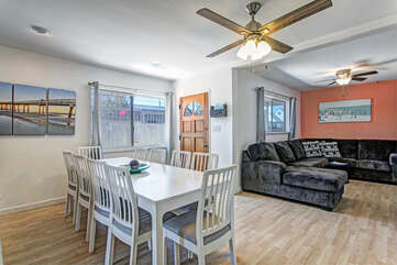 The dining room looks in the family room with a large sectional sofa.