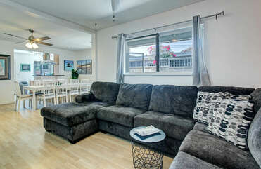 There is a large sectional sofa, perfect for movie night.