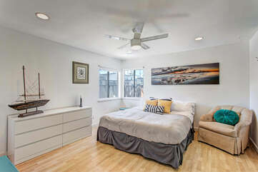 There is a large master suite with two king beds
