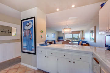 Kitchen opens up to dining room and view of ocean!
