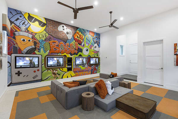 A second games room with an Xbox One and PlayStation 4.