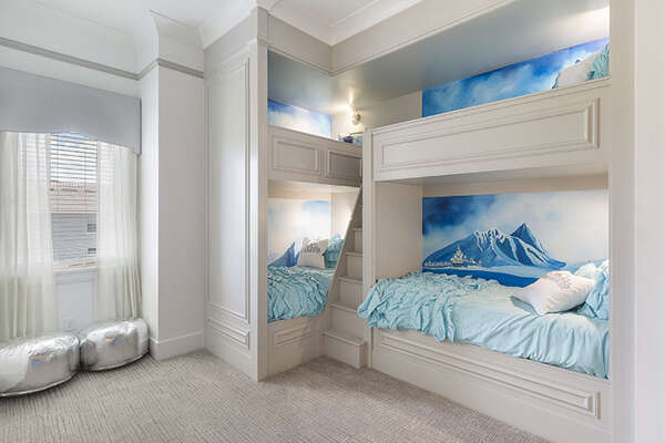 This bedroom features three custom twin/twin bunk beds.