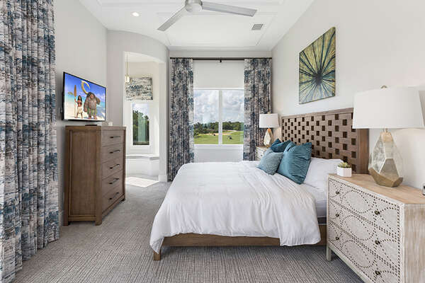 Master Suite 3 king bedroom with views to the golf course on the second floor.