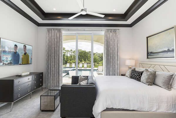 Master Suite 2 with king bed, en-suite bathroom, and access to the pool area.