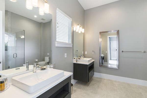 En-suite bathroom with his and her vanities.