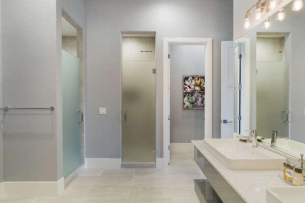 The en-suite bathroom features two walk-in shower.