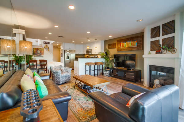 Living Room with couches and fireplace