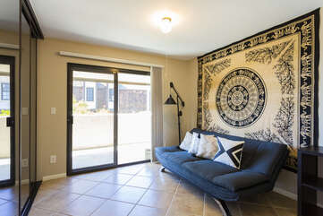 The first bedroom offers a full-size futon with a large tapestry.