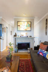 During the colder days, you can turn on the electric fireplace located in the living room.