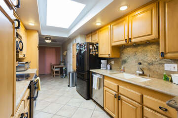 The appliances are top notch and the skylight in the kitchen allows for sunlight to illuminate the kitchen area.