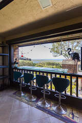 The balcony offers seating for up to 4 people and a bar for your food and drinks.