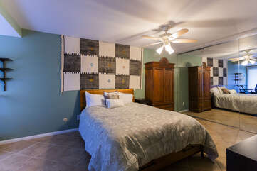 The master bedroom offer a queen bed with a large flat screen TV.