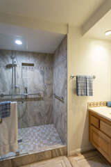The master has an en suite with a beautiful shower.