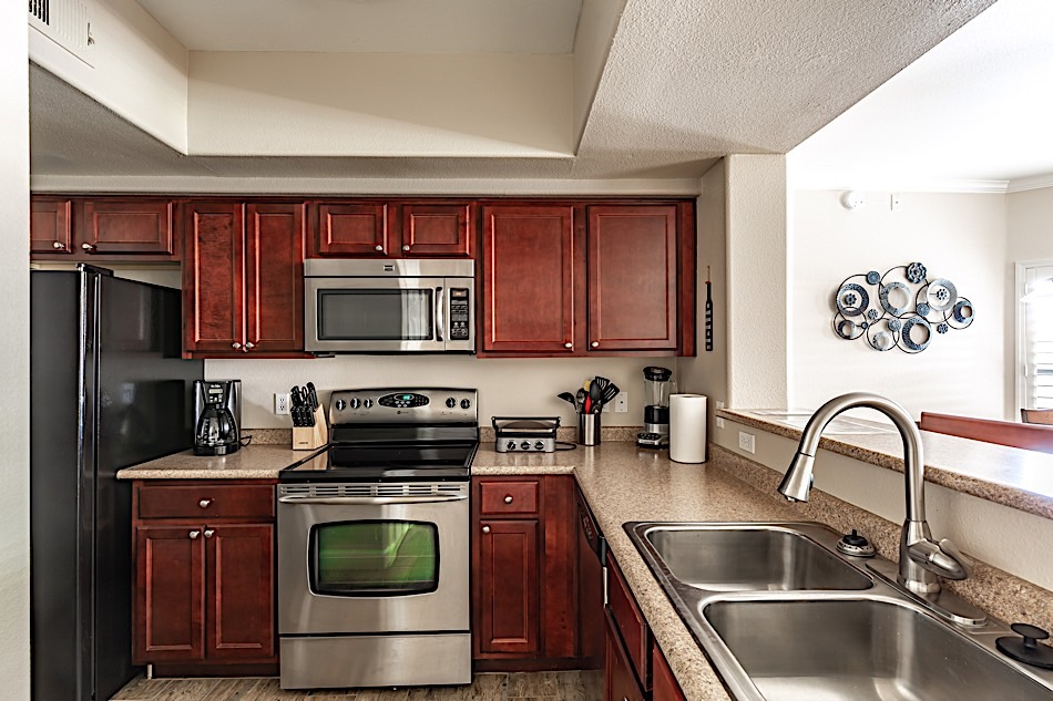 Nice kitchen with cherry wood cabinets and stainless steel appliances