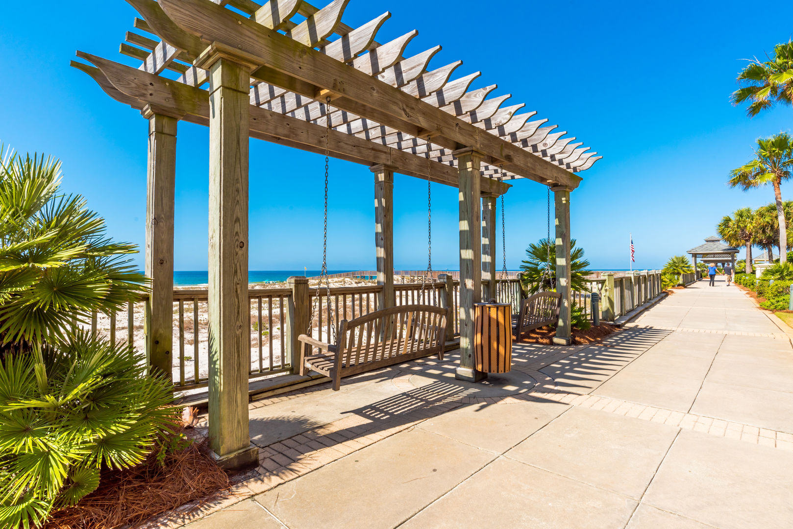 Wooden Beach Swing with Sea View at the Beach Club Resort.