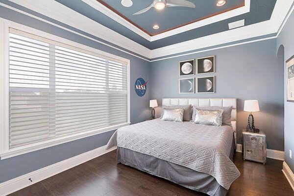 Blast off from this custom NASA-themed bedroom.