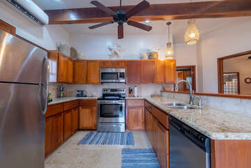 Fully equipped kitchen with new design and light fixtures
