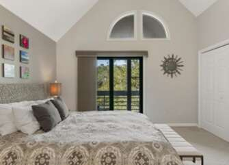 Master bedroom has a queen bed with seagrass frame.