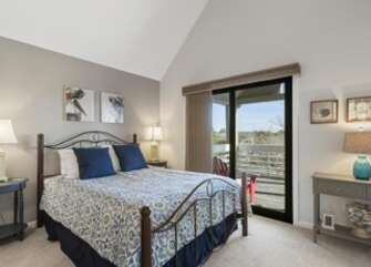 Guest bedroom with queen bed and deck access