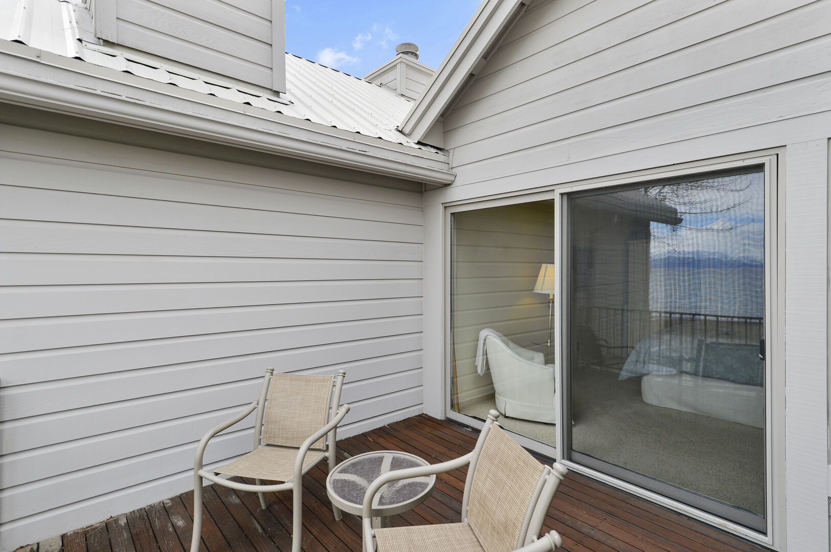 Outdoor Deck, Patio Chairs, Coffee Table, and the Bedroom Sliding Door.