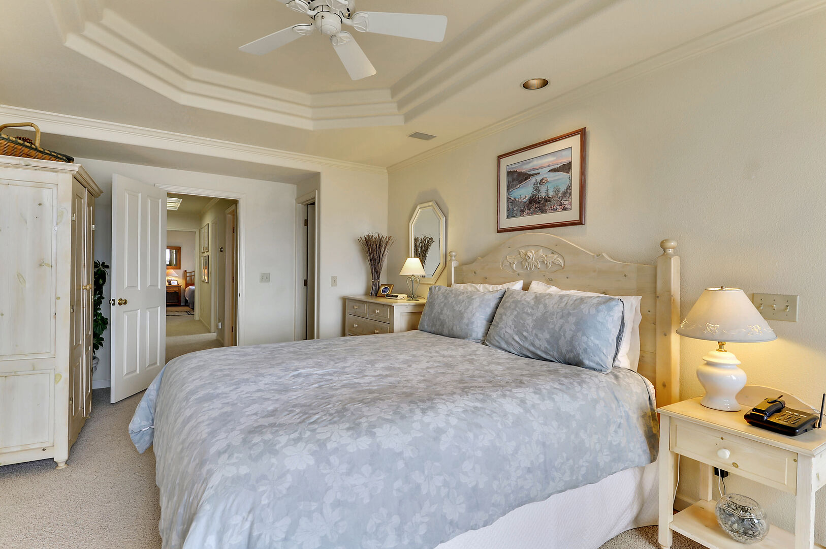 Large Bed, Drawer Dresser, Mirror, Lamp, Nightstand, Wardrobe, and Ceiling Fan.
