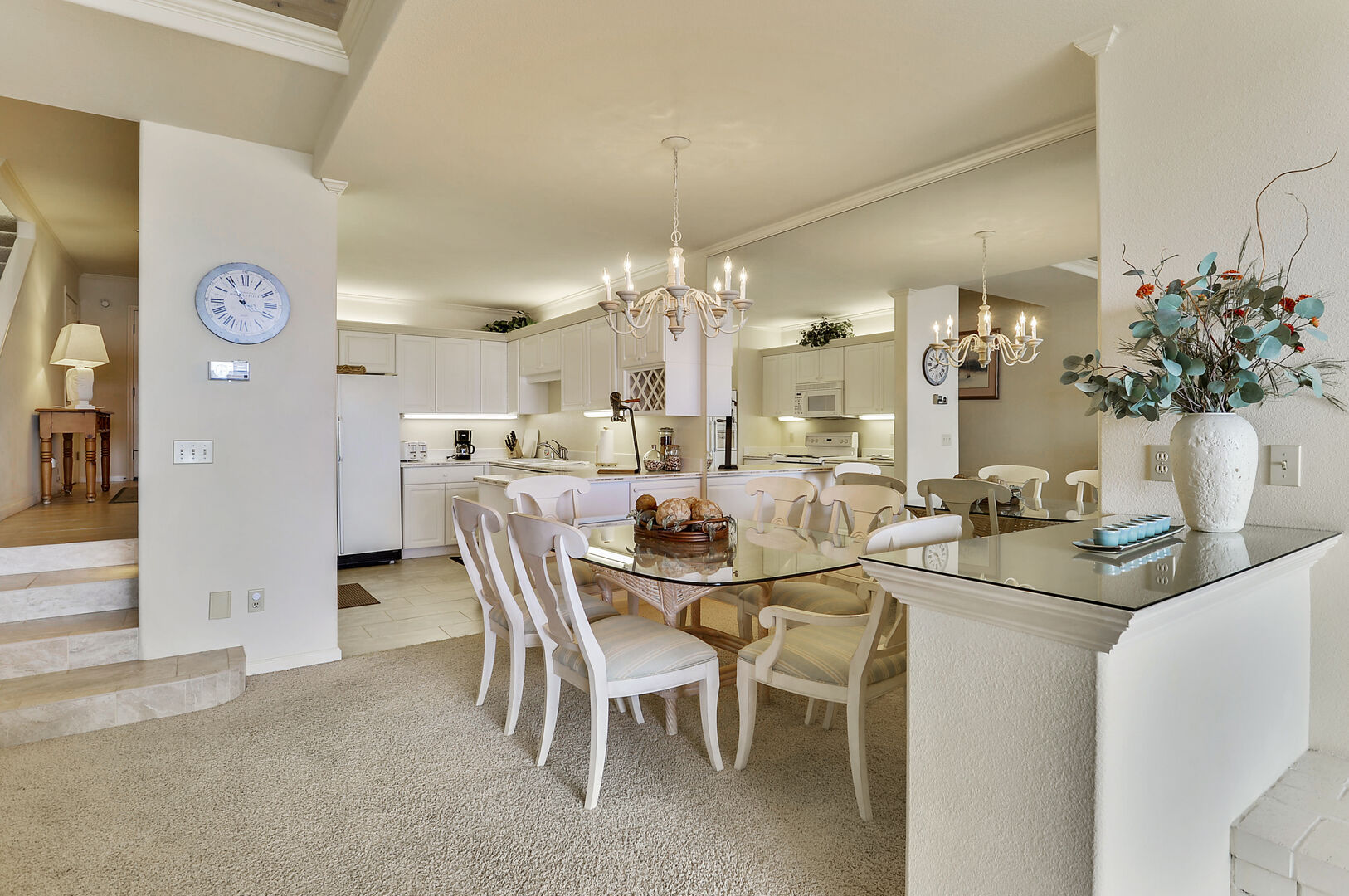 Dining Table, Chairs, Vase, Ceiling Lamp, and the Kitchen.
