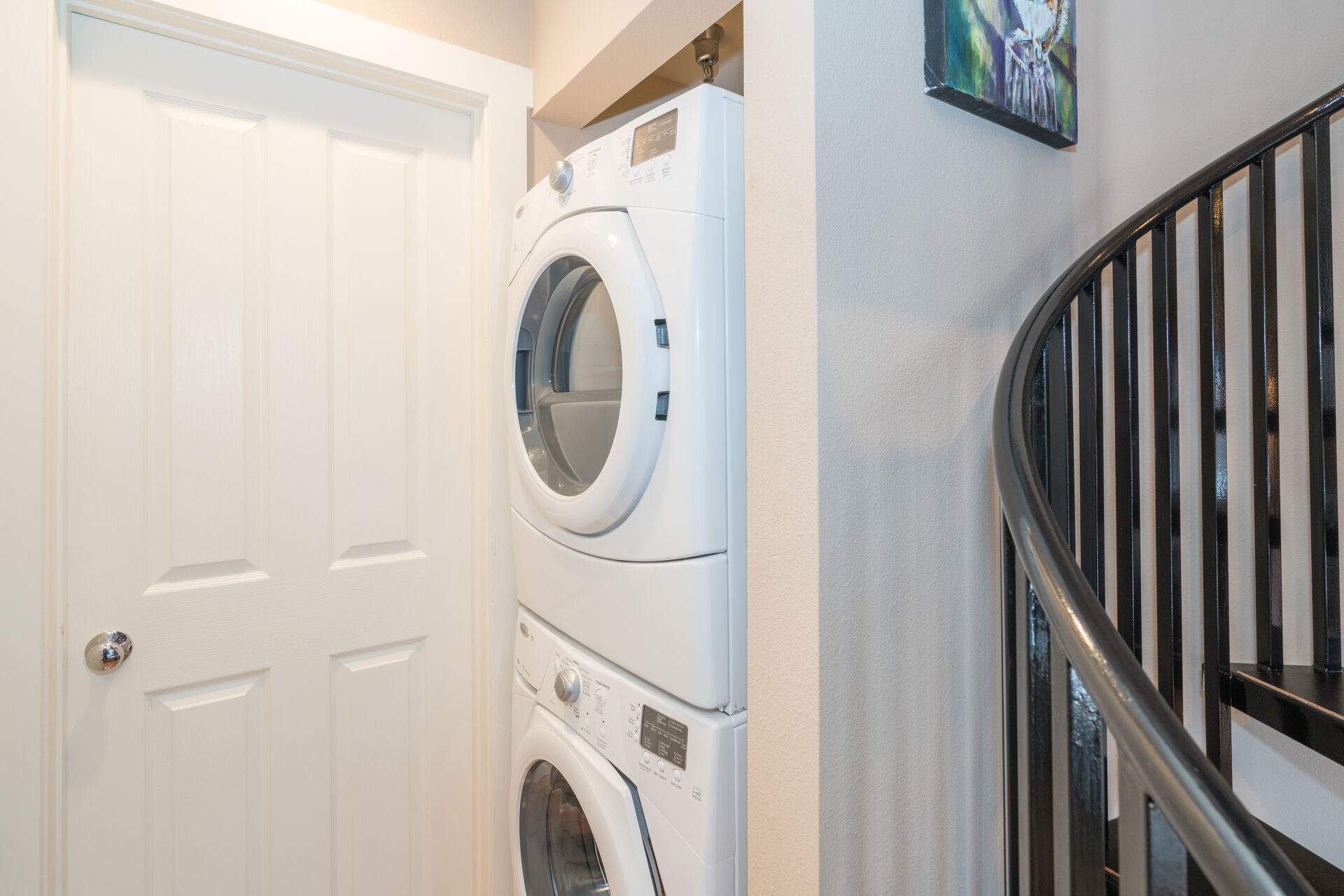 In-Unit Washer and Dryer next to Spiral Staircase to Second Floor at Parker Ridge 503