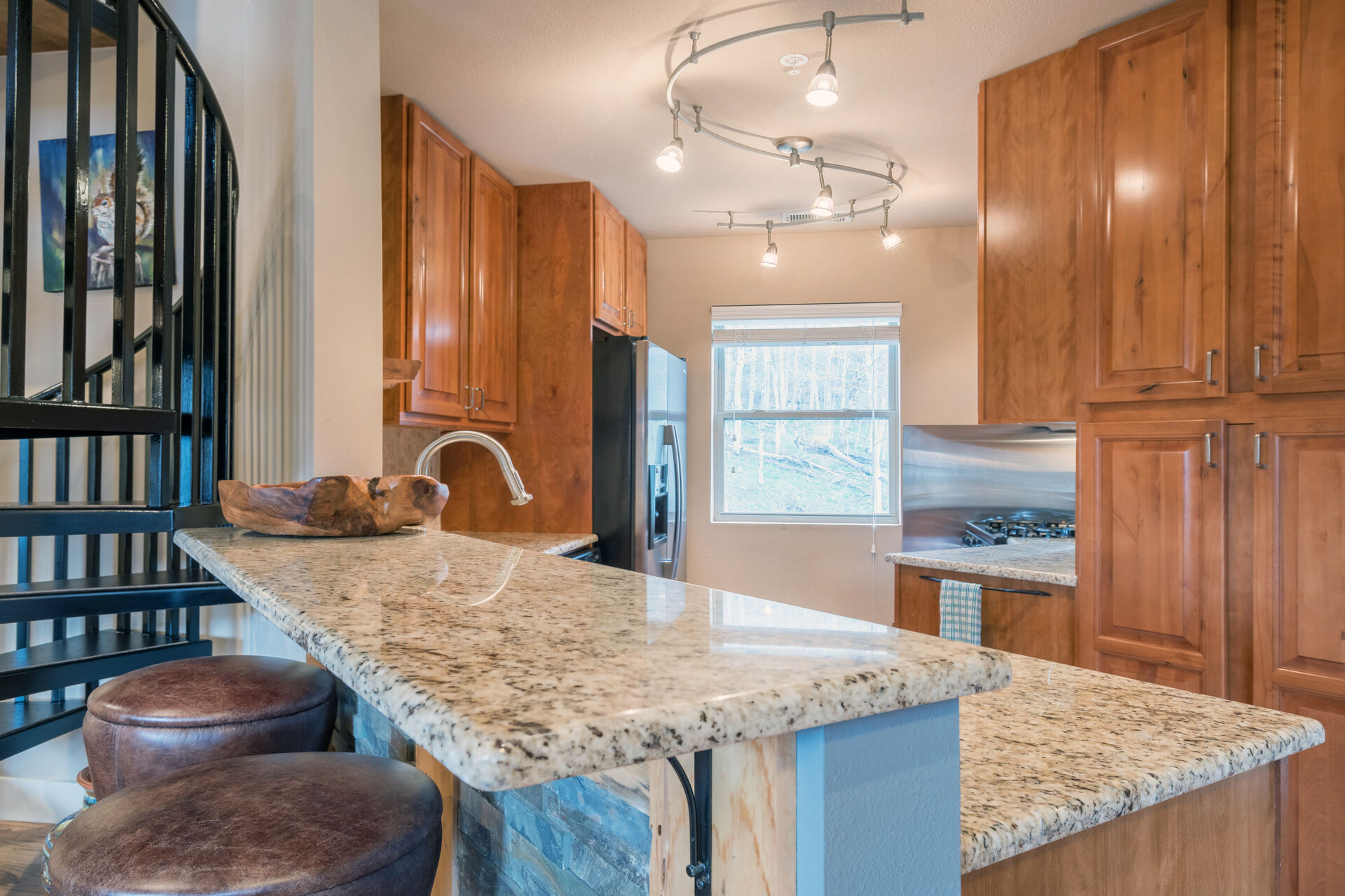 Full Kitchen with Bar Seating and Granite Counter Tops at Telluride Cabin Rental