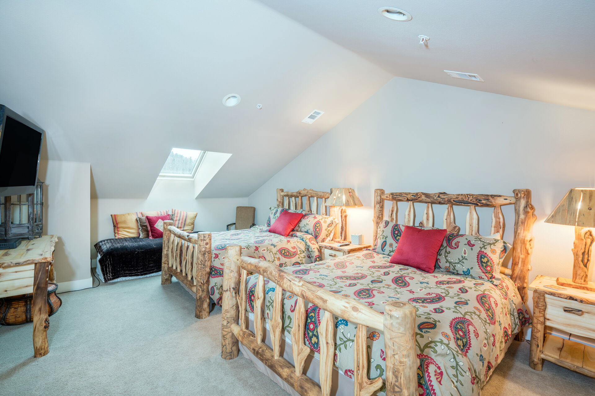 Bedroom with Vaulted Ceilings and Two Beds at Telluride Cabin Rental