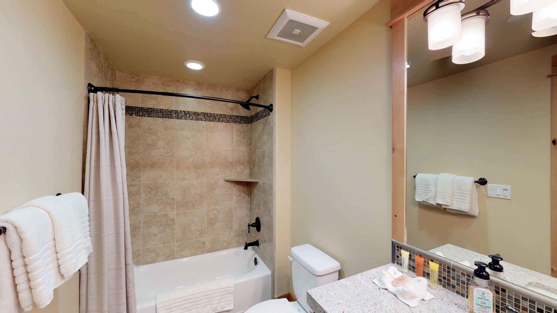 Bathroom in Vacation Rental in Truckee CA Features Bathtub.