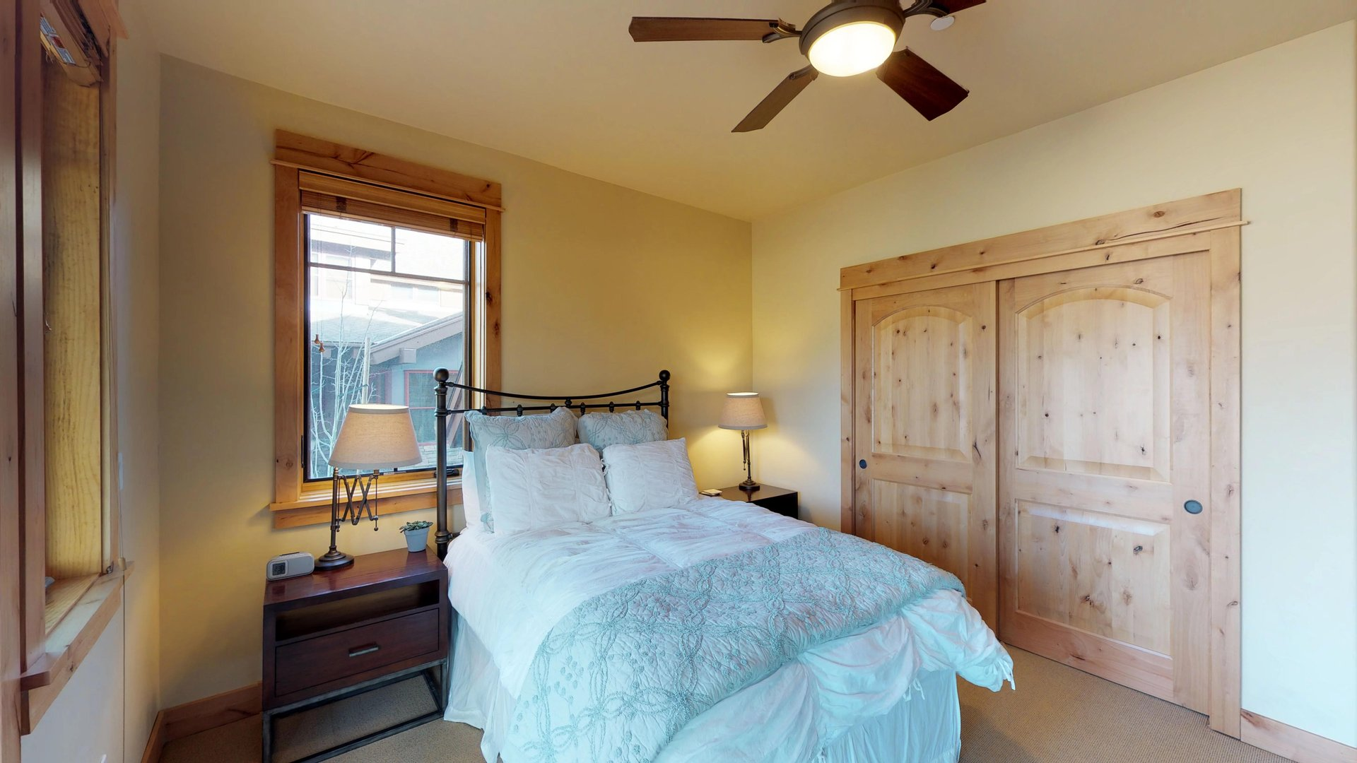 Bedroom in Vacation Rental in Truckee CA Includes Bed and Two Side Tables.