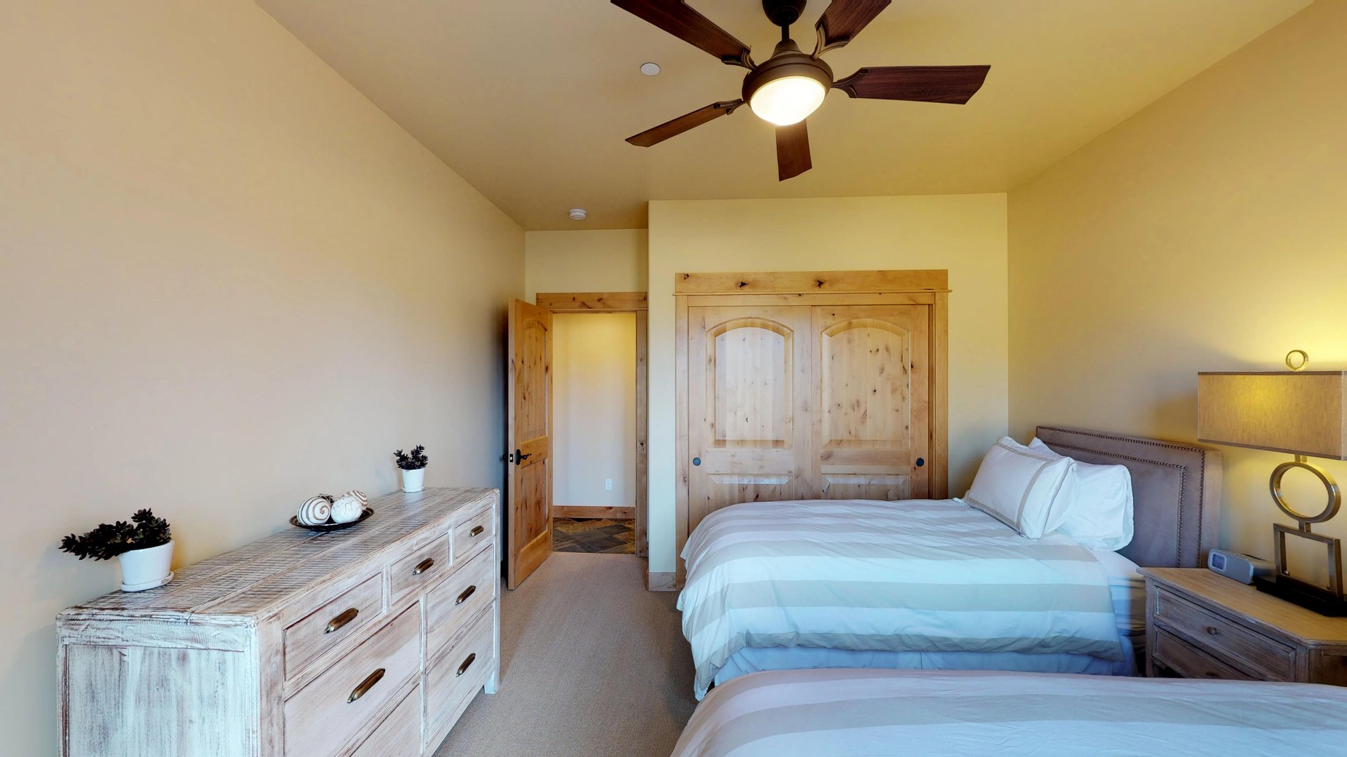 Large Bedroom with Twin Beds Features Wooden Closet.