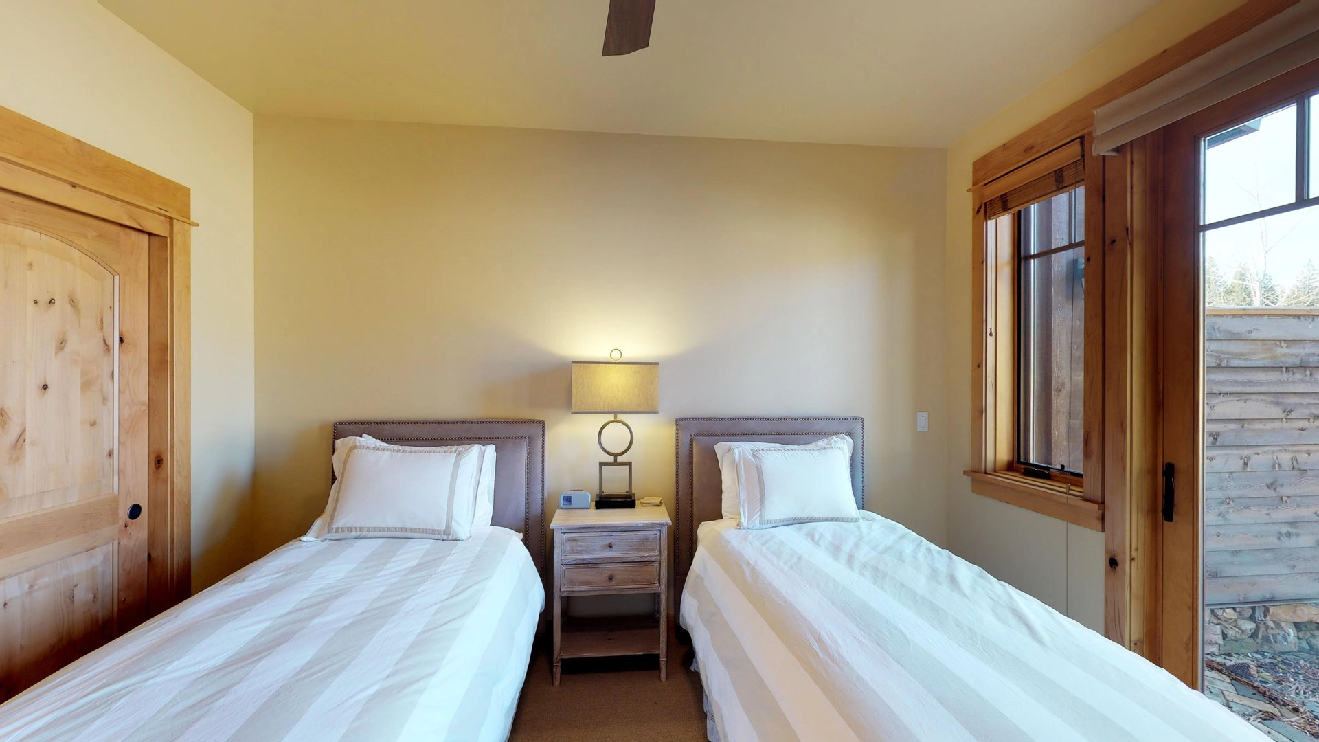 Enjoy Two Twin-Sized Beds and Direct Access Outdoors.