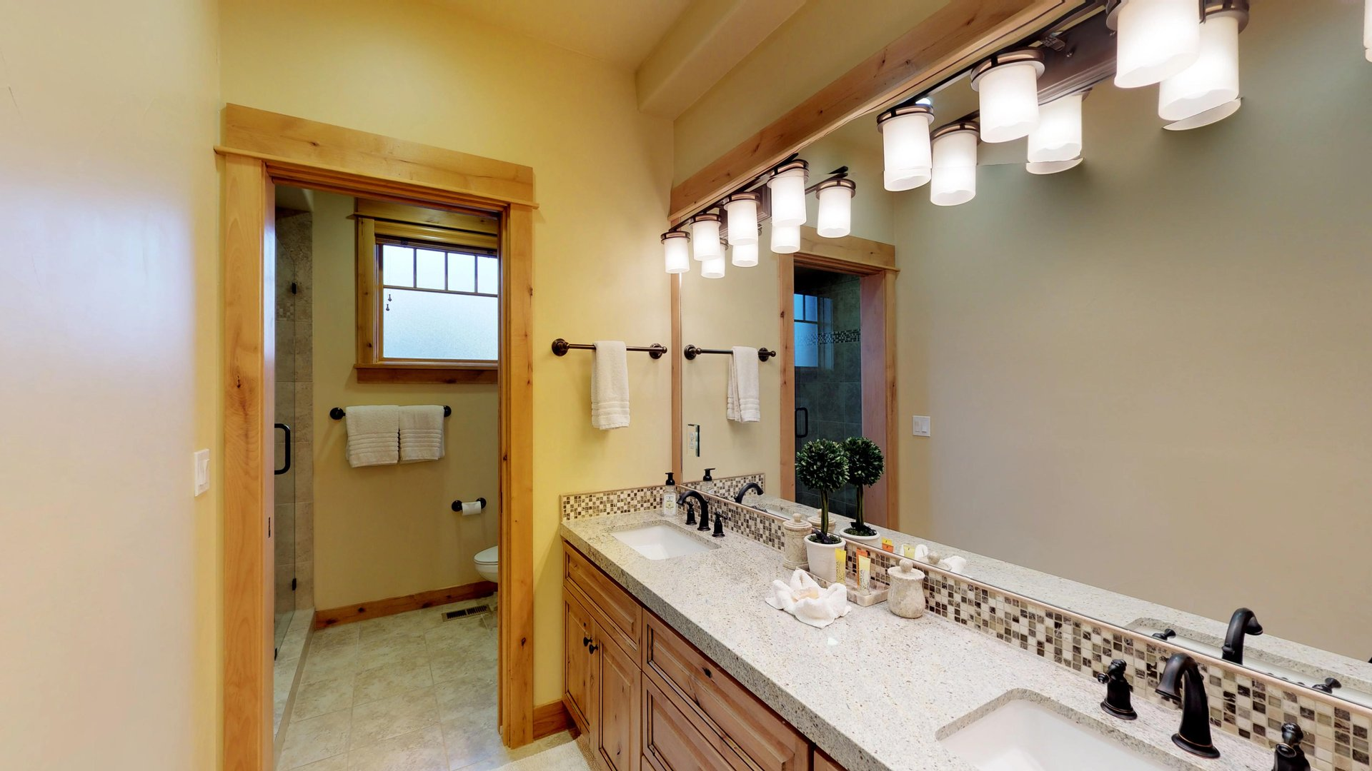 Large Bathroom Includes Two Sinks and Mirror.